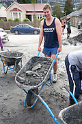 Students from Lincoln University help clean up the silt created from the February 22 earth quake. Christchurch New Zealand 25.02.11. Photo Joe Harrison