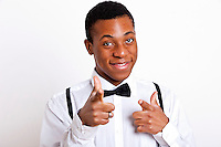 Portrait of young man pointing over white background