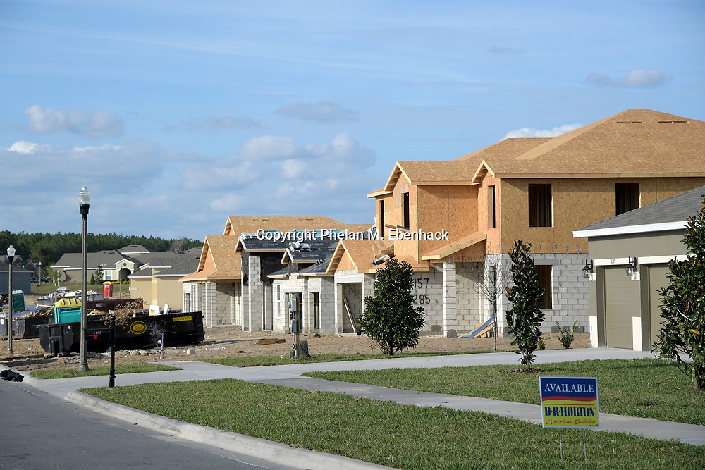 Signs advertise new homes built by D.R. Horton for sale at the Rock Springs Ridge subdivision, Wednesday, Jan. 18, 2017, in Apopka, Fla. (Photo by Phelan M. Ebenhack)
