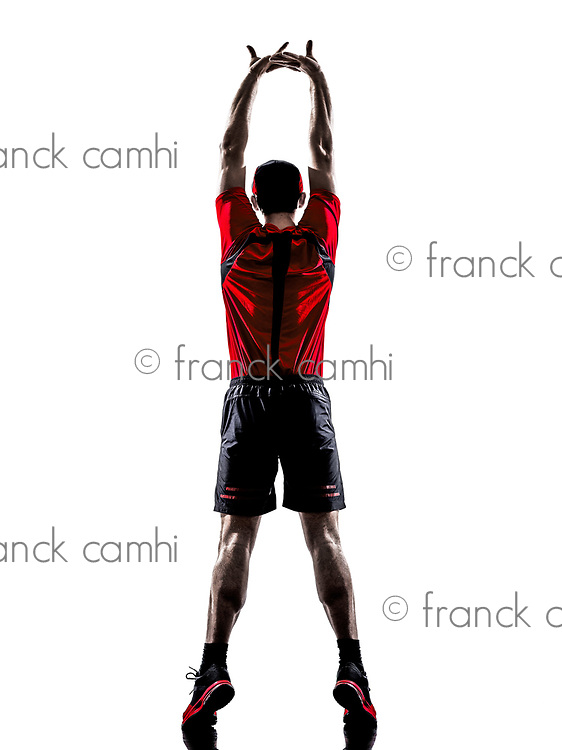one young man runner jogger stretching warming up in silhouette isolated on white background