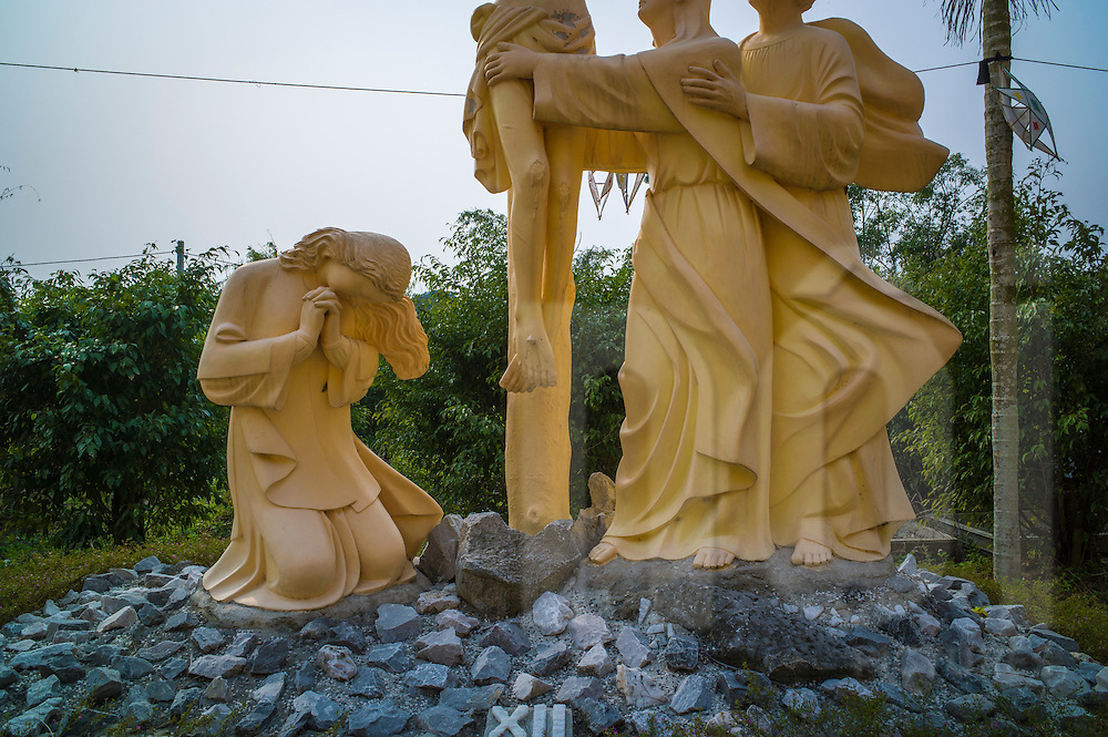 Statue scene of the crucifixion of Jesus beside Phu Oc Church, Nam Dinh City, Nam Dinh Province, Vietnam, Southeast Asia