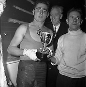 26/01/1962<br /> 01/26/1962<br /> 26 January 1962<br /> Irish Amateur National Junior Boxing Championships at the National Stadium, Dublin. J. fair brother, St. Francis Boxing Club, Limerick, winner of the Middleweight Championship with his trophy.