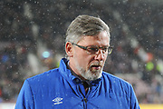 Snow falls as Craig Levein takes to the pitch before the Ladbrokes Scottish Premiership match between Heart of Midlothian and Kilmarnock at Tynecastle Stadium, Gorgie, Scotland on 27 February 2018. Picture by Kevin Murray.