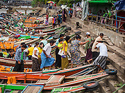 08 JUNE 2014 - YANGON, MYANMAR: Passengers get off a ferry on the Yangon River front in Yangon. Yangon, Myanmar (Rangoon, Burma). Yangon, with a population of over five million, continues to be the country's largest city and the most important commercial center.      PHOTO BY JACK KURTZ