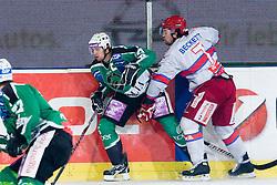 Jason Becket (HK Acroni Jesenice, #7) vs Ziga Pance (HDD Tilia Olimpija, #19) during ice-hockey match between HDD Tilia Olimpija and HK Acroni Jesenice in 41st Round of EBEL league, on Januar 23, 2011 at Hala Tivoli, Ljubljana, Slovenia. (Photo By Matic Klansek Velej / Sportida.com)