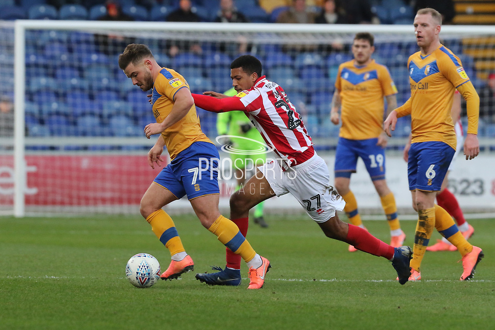 Alex MacDonald and Jonte Smith  during the EFL Sky Bet League 2 match between Mansfield Town and Cheltenham Town at the One Call Stadium, Mansfield, England on 7 December 2019.