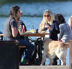 Peaches Geldof and husband Thomas Cohen back from recent trip to Disneyland in Paris, enjoying the sunshine at a park in London. Peaches was wearing a silver flower headband, beige trench coat, blue and white dress. The happy couple who are expecting their second child later this year had a spot of lunch near the pond before taking a stroll around the park with their dog Parpy... London, UK. 06/03/2013<br />BYLINE MUST READ : JAMESY/GOTCHA IMAGES<br /><br />Copyright by © Gotcha Images Ltd. All rights reserved.<br />Usage of this image is conditional upon the acceptance <br />of Gotcha Images Ltd, terms and conditions available at<br />www.gotchaimages.com