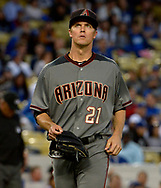 April 14, 2017 - Los Angeles, California, U.S. - Arizona Diamondbacks starting pitcher Zack Greinke walks toward the dugout at the end of the first inning of a Major League baseball game against the Los Angeles Dodgers at Dodger Stadium on Friday, April 14, 2017 in Los Angeles. (Photo by Keith Birmingham, Pasadena Star-News/SCNG) (Credit Image: © San Gabriel Valley Tribune via ZUMA Wire)