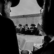 New York - Brooklyn.  The Lubavitch, jewish chassidim sect. Ohel Chabad Lubavitch. Jews praying on the gravesite, of Rabbi Menachem M. Schneerson the Lubavitcher Rebbe, / Les loubavitch, secte juive. ceremonie anniverssaire de la mort du Rabbi Menachem M. Schneerson au cimetiere, Ohel Chabad Lubavitch.  Brooklyn