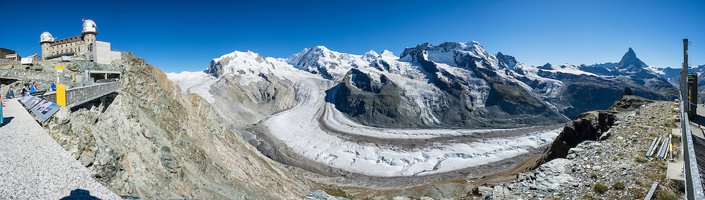 Left to right are the peaks of: Monte Rosa massif / Dufourspitze(4634 m / 15,203 ft, second-highest mountain of the Alps and highest of Switzerland), Liskamm, Castor, Pollux, Breithorn, and Matterhorn, in the Pennine/Valais Alps, Europe. Below is the Gorner Glacier. In Zermatt, the Gornergrat rack railway (GGB) takes you to a spectacular ridge (at 3135 m or 10,285 ft) between Gornergletscher and Findelgletscher, with views of more than twenty 4000-meter-high peaks. Gornergrat train, opened in 1898, climbs almost 1500 m or 4900 ft via Riffelalp and Riffelberg. This image was stitched from multiple overlapping photos.