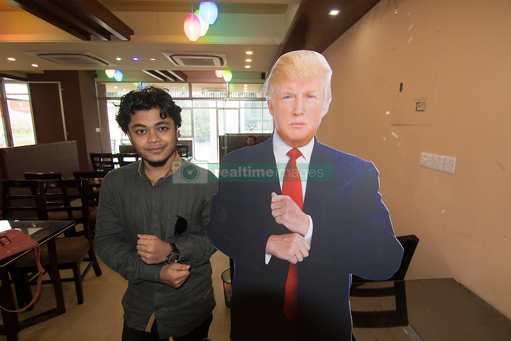 """August 13, 2017 - Dhaka, Bangladesh - Donald Trump's fanbase in Dhaka, Bangladesh now has an official hangout spot — a restaurant here which has been named Trump Cafe in the US President's honour. Saiful Islam, a Bangladeshi entrepreneur and a big fan of Trump, founded the cafe and decided to use the President's name for his coffee shop in Dhaka. Bringing his idea to fruition was not easy. Saiful had to prove to the authorities that he was the real owner of the business and the President had nothing to do with it. The 'Trump Cafe' offers Chinese, Indian and Thai cuisine and other fast food items on its menu. """"I did not start the business with any specific thought in mind, just the fact that I am a big fan of US President Donald Trump,"""" Saiful was quoted as saying..Along with other regular favorites, the cafe also serves some food items inspired by Trump such as the special Trump Cocktail or the Green Apple Mocktail. """"My uncle, Kabir Ali, is the manager at a Trump-owned restaurant in the US. It was initially his idea to start a restaurant, and since I am a big fan as well, I wanted to get involved in the venture,"""" said Saiful. Even though Trump remains unaware of the existence of the restaurant and bears no connection to it, Saiful is happy to be a part of the restaurant named after Trump, the report said..""""Many people think he is a joke, but he is an inspiration for me. If you look at his business ventures, you will see that he is quite successful and shrewd at doing business. That is what inspires me,"""" Saiful said. One of the attractions of the cafe is a Trump cutout that people can take pictures with.Even the cafe's wifi password is named after a Trump family member, the report said. Despite formally opening more than two months ago, the owners are planning a grand opening within the next two months. (Credit Image: © Azim Khan Ronnie/Pacific Press via ZUMA Wire)"""