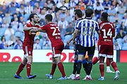 Fulham midfielder Harry Arter (18) is held back by Fulham defender Joe Bryan (23) during a flashpoint with Sheffield Wednesday forward Sam Winnall (11) during the EFL Sky Bet Championship match between Sheffield Wednesday and Fulham at Hillsborough, Sheffield, England on 21 September 2019.