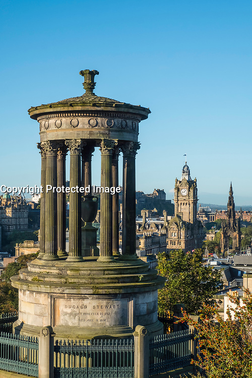 Dugald Stewart monument and skyline of Edinburgh from Calton Hill in early morning sunshine, Scotland, United Kingdom.
