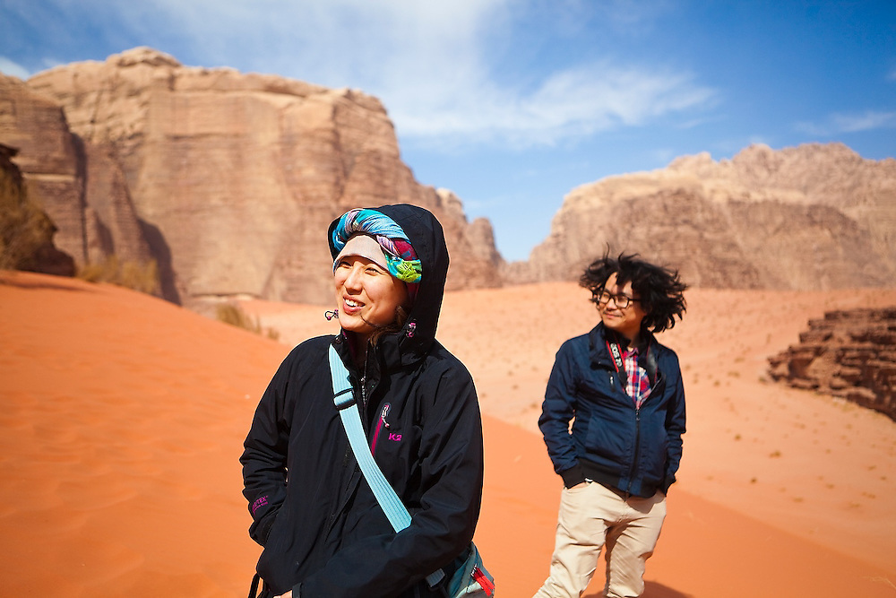 Yoesun Lim (left) and SeongRyeong Bak stand on a red sand dune in Wadi Rum, Jordan.