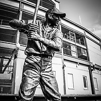 "Ernie Banks statue at Wrigley Field in black and white. Known a ""Mr. Cub"" Ernie Banks was a first baseman for the Chicago Cubs and in the Baseball Hall of Fame. Wrigley Field is home of the Chicago Cubs and was built in 1914 making it one of the oldest baseball stadiums in the United States."