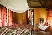 Interior of bure guest room at Bulou's Eco Lodge, Navala Village, Viti Levu Island, Fiji.