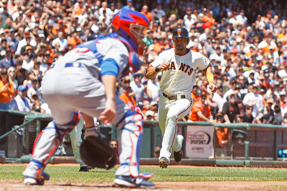 SAN FRANCISCO, CA - JUNE 03: Angel Pagan #16 of the San Francisco Giants runs towards Koyie Hill #55 of the Chicago Cubs at home plate to score a run during the fifth inning at AT&T Park on June 3, 2012 in San Francisco, California. (Photo by Jason O. Watson/Getty Images) *** Local Caption *** Angel Pagan; Koyie Hill