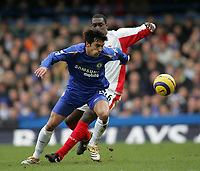 Photo: Lee Earle.<br /> Chelsea v Birmingham City. The Barclays Premiership.<br /> 31/12/2005.<br /> Chelsea's Paulo Ferreira (R) holds off Emile Heskey.