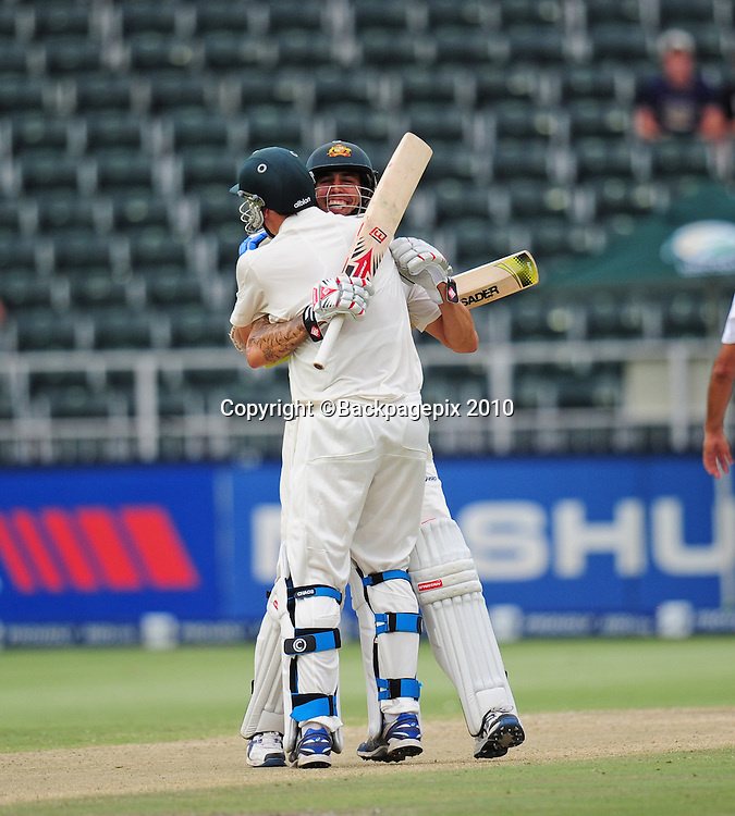 Patrick Cummins celebrates with Mitchell Johnson of Australia after hitting the winning runs, Cricket - 2011 Sunfoil Test Series - South Africa v Australia - Day 5 - Wanderers Stadium<br /> &copy;Chris Ricco/Backpagepix