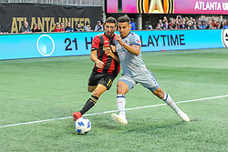 October 21, 2018 - Atlanta, GA, U.S. - ATLANTA, GA - OCTOBER 21: Atlanta United midfielder Eric Remedi (11) and Chicago Fire defender Brandon Vincent (3) contest for the ball during the MLS game between the Atlanta United and the Chicago Fire on October 21, 2018 at the Mercedes-Benz Stadium in Atlanta, GA. Atlanta United FC secured a place in next year's CONCACAF Champions League with a 2-1 victory against the visiting Chicago Fire. (Photo by John Adams/Icon Sportswire) (Credit Image: © John Adams/Icon SMI via ZUMA Press)