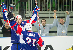 Tomaz Razingar of Slovenia and Andrej Hebar of Slovenia celebrate during ice-hockey match between Great Britain and Slovenia at IIHF World Championship DIV. I Group A Slovenia 2012, on April 15, 2012 in Arena Stozice, Ljubljana, Slovenia. (Photo by Vid Ponikvar / Sportida.com)