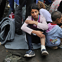 Syrian refugee girl crying in pain, from an injured leg  at collection point number 1 near Röszke. where refugees were required by the Hungarian police to be taken by bus for registration. This site is a kilometre in from a gap in the border fence along an old railway line, one of the principal access routes used by refugees entering Hungary from Serbia.   Food and basic supplies were available here thanks to donations and volunteers, with support from UNHCR. Thousands of refugees crossed the border into Hungary heading towards Western Europe, until a 15 September deadline set by the Hungarian authorities to seal its border fence and bring in new restrictive laws limiting access of refugees to its territory, effectively stopping the flow of refugees.