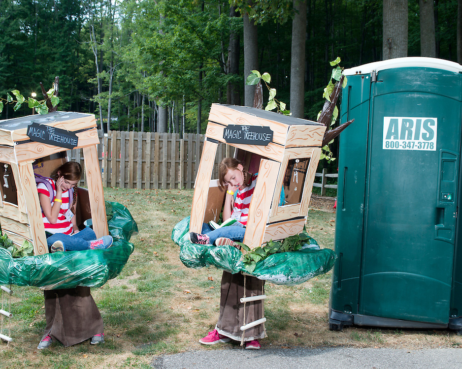 """Eva and Johanna Gill of Howell, Michigan are dressed as """"The Magic Treehouse"""" at the 40th annual Twins Days Festival in Twinsburg, Ohio. When the twins were born, they shared the same placenta and were not expected to survive.  They now participate in research studies to study this twin-based illness. Mom: Anglea: 517-219-7312"""