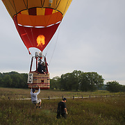 Miloslav Skorpik, Czech Republic and his crew land in rural Michigan near Battle Creek during the World Hot Air Ballooning Championships. Battle Creek, Michigan, USA. 19th August 2012. Photo Tim Clayton
