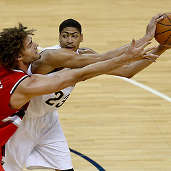 Dec 30, 2013; New Orleans, LA, USA; New Orleans Pelicans power forward Anthony Davis (23) is defended by Portland Trail Blazers center Robin Lopez (42) during the first half of a game at the New Orleans Arena. Mandatory Credit: Derick E. Hingle-USA TODAY Sports