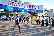 BELLVILLE, SOUTH AFRICA - Wednesday 3 December 2014, Unathi Nteta wins the Metropolitan 10km road race outside the Parc Du Cap head office in Bellville.<br /> Photo by IMAGE SA / Roger Sedres