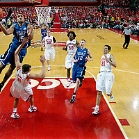 27 January 2008:   Duke University Blue Devils guard Gerald Henderson (15) scores in the 1st half as he is fouled by Maryland Terrapins guard Eric Hayes (5) at the Comcast Center in College Park, MD.  The Duke Blue Devils defeated the Maryland Terrapins 93-84.