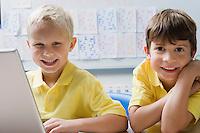 Schoolboys Using a Laptop
