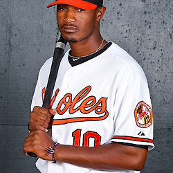 February 26, 2011; Sarasota, FL, USA; Baltimore Orioles center fielder Adam Jones (10) poses during photo day at Ed Smith Stadium.  Mandatory Credit: Derick E. Hingle