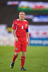 HELSINKI, FINLAND - Saturday, October 10, 2009: Wales' captain Craig Bellamy walks off dejected as his side lose 2-1 to Finland during the 2010 FIFA World Cup Qualifying Group 4 match at the Olympic Stadium. (Pic by David Rawcliffe/Propaganda)