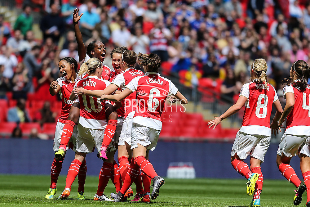 Arsenal players celebrate Arsenal Ladies forward Danielle Carter's goal, 1-0 during the SSE Women's FA Cup Final match between Chelsea Ladies and Arsenal Ladies at Wembley Stadium, London, England on 14 May 2016. Photo by Shane Healey.