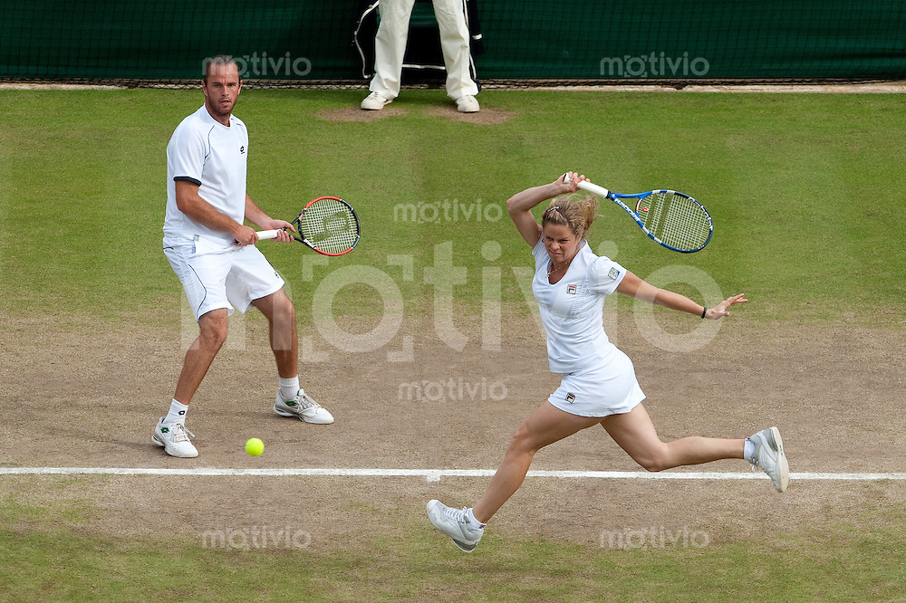 Xavier Melisse (BEL) and Kim Clijsters (BEL) play against Marcelo Melo (BRA) and Rennae Stubbs (AUS) on Court 1. The Wimbledon Championships 2010 The All England Lawn Tennis & Croquet Club  Day 10 Thursday 01/07/2010
