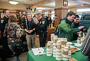 "Ohio University junior Daniel Parsons and sophomore Megan Cummings speak with Lieutenant Tim Ryan and Chief of Police Andrew Powers, while juniors Cole Decker and Chris Koester get coffee in The Front Room Coffee House on Thursday, January 22 for ""Coffee with a Cop."" The event encouraged members of the commuity to spend time getting aquainted with law enforcement officials."