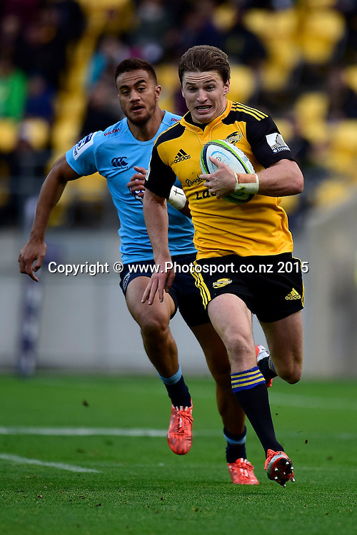 Hurricanes' fly-half Beauden Barrett  (Front) runs in a try chased by Waratahs' Peter Betham during the Super Rugby - Hurricanes v Waratahs rugby union match at the Westpac Stadium in Wellington on Saturday the 18th of April 2015. Photo by Marty Melville / www.Photosport.co.nz