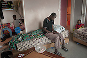 10 years ago, on 27 October 2005 riots broke out in the French suburbs.  It started here with the death of two boys, in Clichy sous Bois, 15 km from Paris, an economically deprived suburb.  Dansoko Baraka comes from Mali, he has 6 children (from 18 to 2 years). He is handicapped after he cut a nerve in his left arm trying to change the windows in this apartment. He came to France in 1991, working as a security guard. He pays 600 euro rent, his wife works part time. Housing complex Chene Pointu. 7 March 2015, Clichy sous Bois, France.