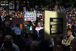 "© Licensed to London News Pictures. 31/08/2019. Manchester, UK. A placard reading ""Defending our democracy stop the coup "" . Thousands attend a pro EU demo in Albert Square in Manchester City Centre , with objections raised to the Prime Minister Boris Johnson's intention to prorogue Parliament in the run up to Britain's planned Brexit deadline . Photo credit: Joel Goodman/LNP"