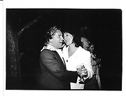 Don Johnson and Angelica Huston. Ben Bradlee book party. E. Hampton. 26 August 1995. © Copyright Photograph by Dafydd Jones 66 Stockwell Park Rd. London SW9 0DA Tel 020 7733 0108 www.dafjones.com