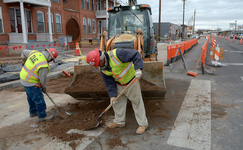 gbs120716i/ASEC --  Joseph Metteba, left, and Felix Martinez with TLC work at Central and 10th Street on Wednesday, December  7, 2016. Albuquerque Rapid Transit will cause the loss of some on-street parking spaces in the area, from 23 to nine. (Greg Sorber/Albuquerque Journal)
