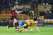 Wolverhampton Wanderers forward Diogo Jota (18) loses out during the Premier League match between Wolverhampton Wanderers and Bournemouth at Molineux, Wolverhampton, England on 15 December 2018.