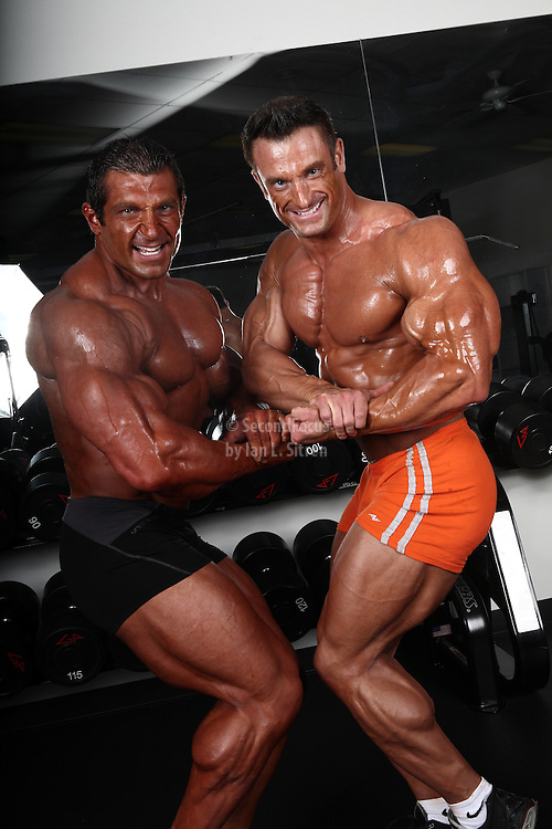 Bodybuilders Dan Decker and Brian Yersky posing and flexing together.