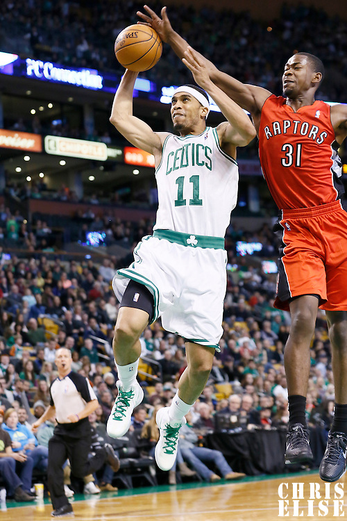 17 November 2012: Boston Celtics shooting guard Courtney Lee (11) is fouled by Toronto Raptors shooting guard Terrence Ross (31) as he goes for the dunk during the Boston Celtics 107-89 victory over the Toronto Raptors at the TD Garden, Boston, Massachusetts, USA.