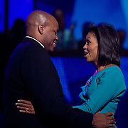 Michelle Obama is introduced by her brother, Craig Robinson, at the Democratic National Committee (DNC) Convention on the first day at the Pepsi Center in Denver, Colorado (CO) Monday, Aug. 25, 2008.  ..Photo by Khue Bui