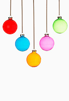 Five Christmas baubles on white background