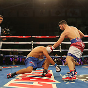 TAMPA, FL - FEBRUARY 28:  Julian Rodriguez (R) knocks down Raul Tovar during the SoloBoxeo Tecate boxing match at the University of South Florida Sundome on February 28, 2015 in Tampa, Florida. Rodriguez won the bout by knocking down Tovar three times in the first round.  (Photo by Alex Menendez/Getty Images) *** Local Caption *** Julian Rodriguez; Raul Tovar