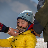 Tibetan parents teach their children that all life is precious and to honor everyone.