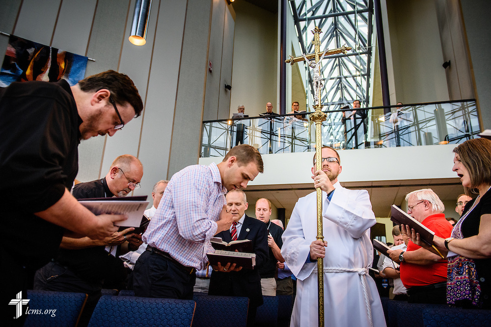 Jon Kohlmeier, communications and technology coordinator at LCMS Iowa District-East, carries the processional cross as crucifer at worship during floor-committee weekend at the International Center of The Lutheran Church–Missouri Synod on Saturday, May 28, 2016, in Kirkwood, Mo. LCMS Communications/Erik M. Lunsford